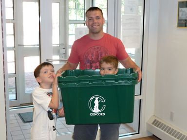 Recycling Bin With 2 Kids and Man