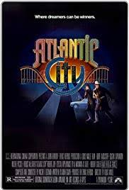 Movie Poster for Atlantic City showing an arty Atlantic City logo nestled in the curve of a roller c