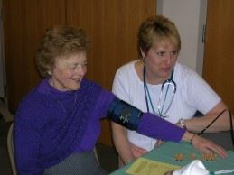 Nurse checks patient's blood pressure