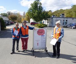 Group of Women Standing Next to DropOff Sign